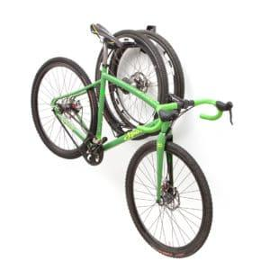 bicycle hanging from rack with wheels