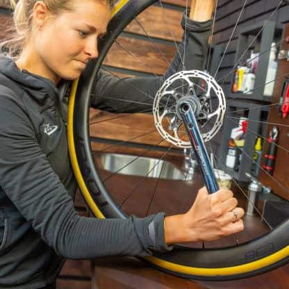 mechanic removing bicycle rotor