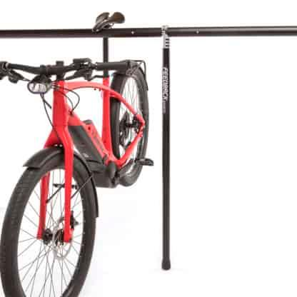 bicycle hanging on stand