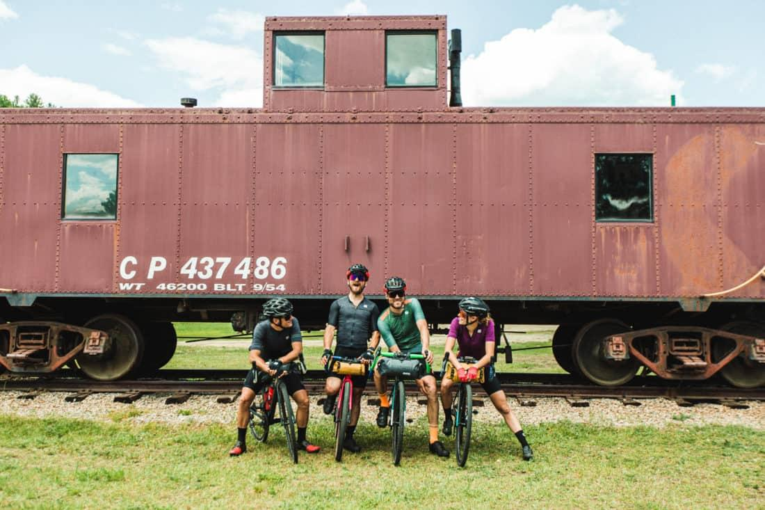 cyclists in front of train
