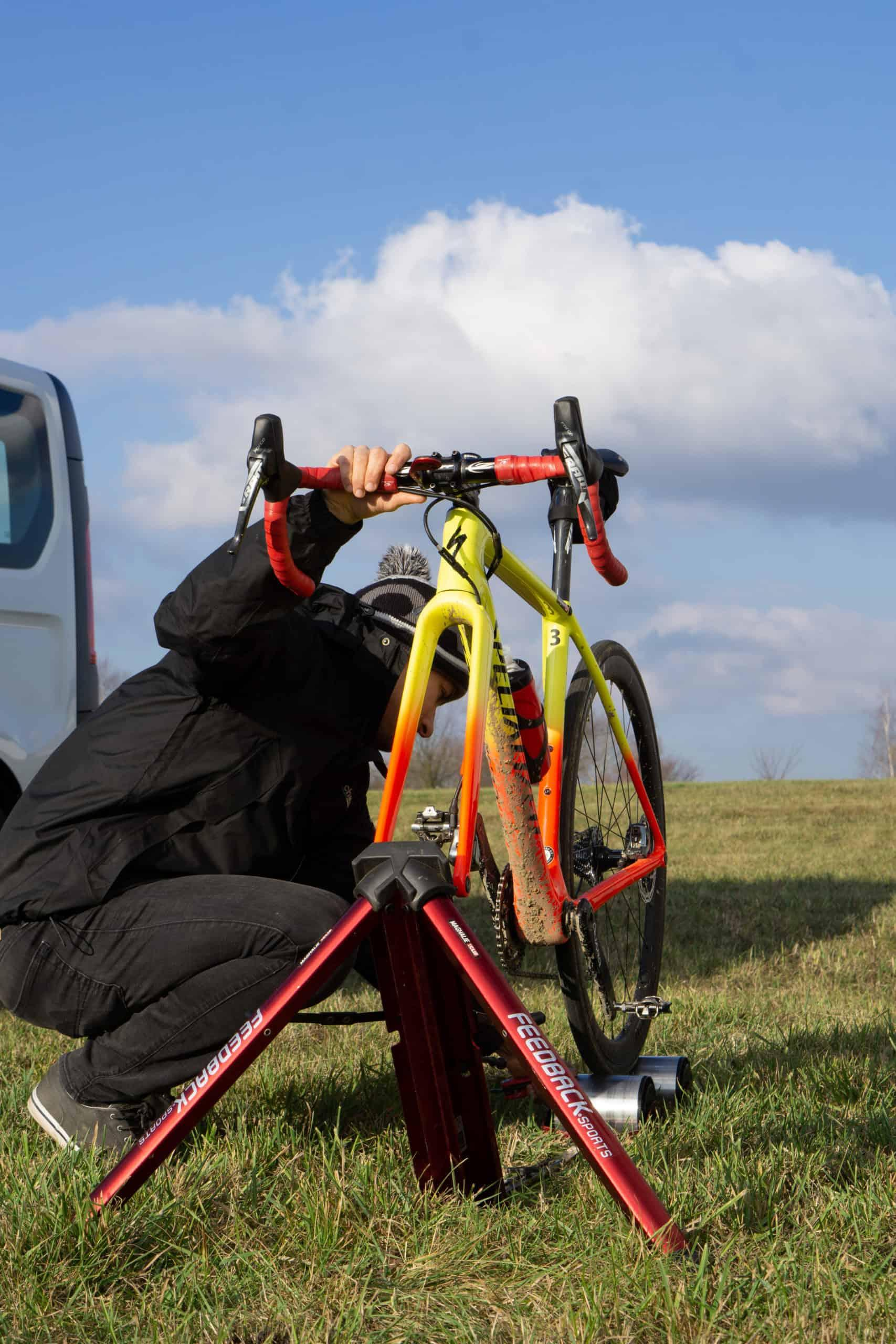 mechanic sets up bicycle on stationary trainer